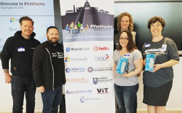 PCS Folder (right) with judges Emily McMahan (Bunker Labs), Justin Johnson (Stackpath), and Josh Carter (Patriot Boot Camp) left.